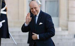Le ministre des Affaires étrangères Laurent Fabius arrive à l'Elysée, le 2 avril 2014 à Paris