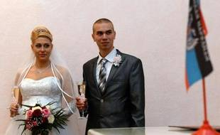 Ioulia et Dmitri Kolobov lors de leur mariage le 27 décembre 2014 à Donetsk