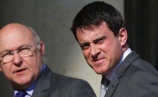 Manuel Valls, ministre de l'Intérieur et Michel Sapin, ministre du Travail, le 24 avril 2013