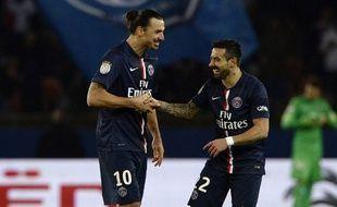 Ibrahimovic et Lavezzi célèbrent le 2e but du Suédois lors de PSG-Nantes (2-1), le 6 décembre 2014.