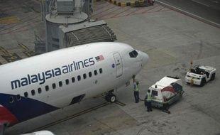 Un avion de la Malaysia Airlines, à l'aéroport international de Kuala Lumpur le 13 mars 2014