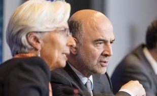 La directrice générale du FMI Christine Lagarde et le commissaire européen aux affaires financières Pierre Moscovici lors d'une conférence de presse à Luxembourg le 18 juin 2015