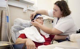 Illustration d'une patiente souffrant d'un cancer du sein à l'Institut Curie.