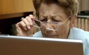 Illustration - Une personne devant un ordinateur portable