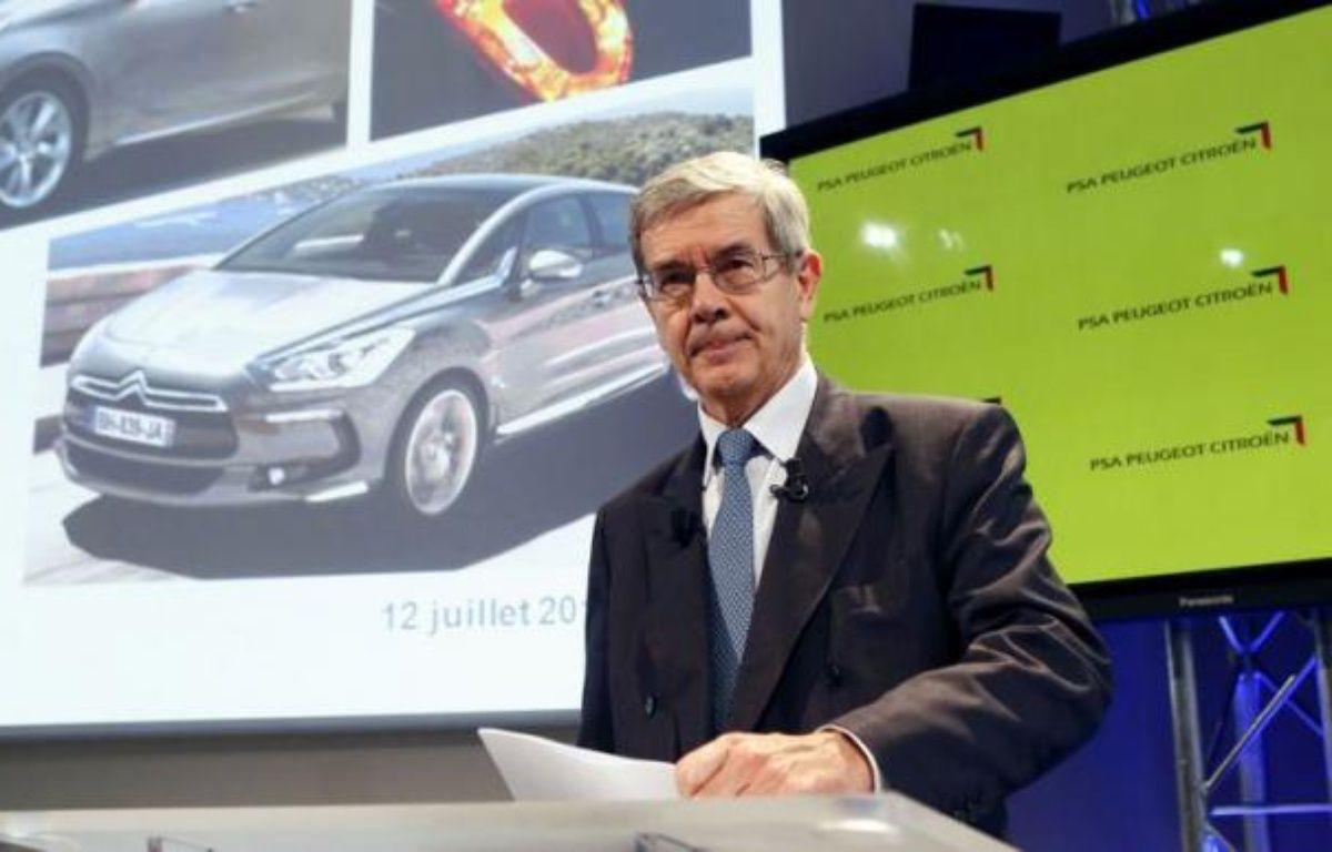 """Le président du directoire de PSA Peugeot Citroën Philippe Varin, dont le groupe a annoncé jeudi un plan de suppression de 8.000 postes en France, s'est prononcé pour une baisse """"massive"""" du coût du travail en France. – Patrick Kovarik afp.com"""