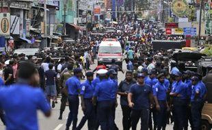 Vers 10 heures, dimanche matin, le bilan faisait état de 156 morts lors de six explosions au Sri Lanka.