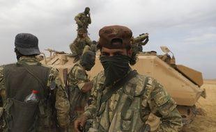 Des supplétifs syriens des troupes turques près de la ville de Ras al-Ayn, en Syrie, vendredi 19 octobre.