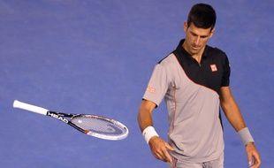 Le Serbe Novak Djokovic lors de son élimination en quart de finale de l'Open d'Australie contre Stanislas Wawrinka, le 21 janvier 2014, à Melbourne.