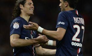 Les Parisiens Edinson Cavani et Javier Pastore ont largement contribué à la large victoire du PSG contre Saint-Etienne (5-0), lors de la 4e journée de Ligue 1, le 31 août 2014.