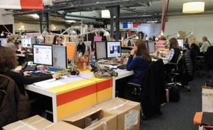 Des personnes travaillent dans les bureaux de la société «vente-privee.com», le 14 janvier 2010 dans son bureau à la  Plaine Saint-Denis.