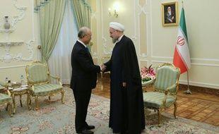 Le chef de l'Agence internationale de l'énergie atomique (AIEA), Yukiya Amano, et  le président iranien, Hassan Rohani à Téhéran ole 18 janvier 2016