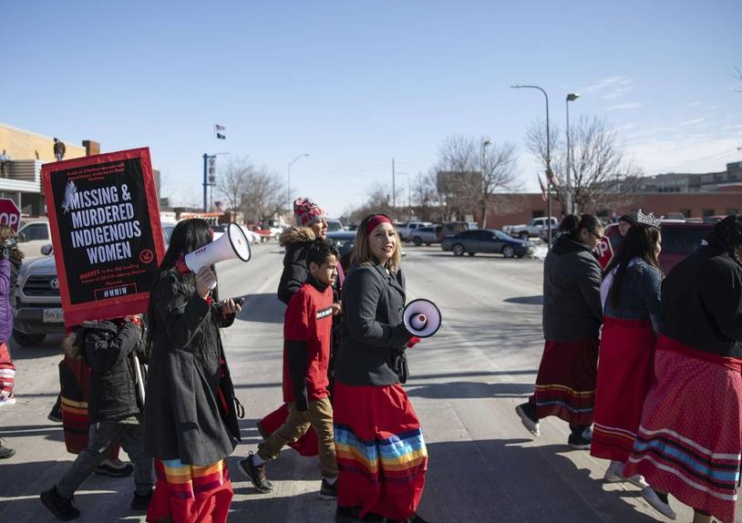 People participate in a march in downtown Rapid City, S.D., Thursday, Feb. 14, 2019, to call attention to missing and murdered Native American women and girls. (Ryan Hermens/Rapid City Journal via AP)/SDRAP321/19046158214352/MANDATORY CREDIT/1902150640