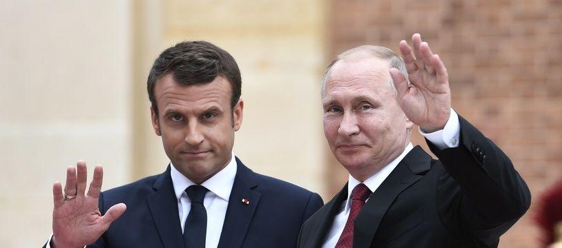 Emmanuel Macron et Vladimir Poutine, le 24 mai 2018, à Saint-Pétersbourg, en Russie.