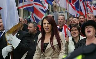 Deputy leader of the far-right organisation Britain First, Jayda Fransen gestures as she participates in a march in central London on April 1, 2017.