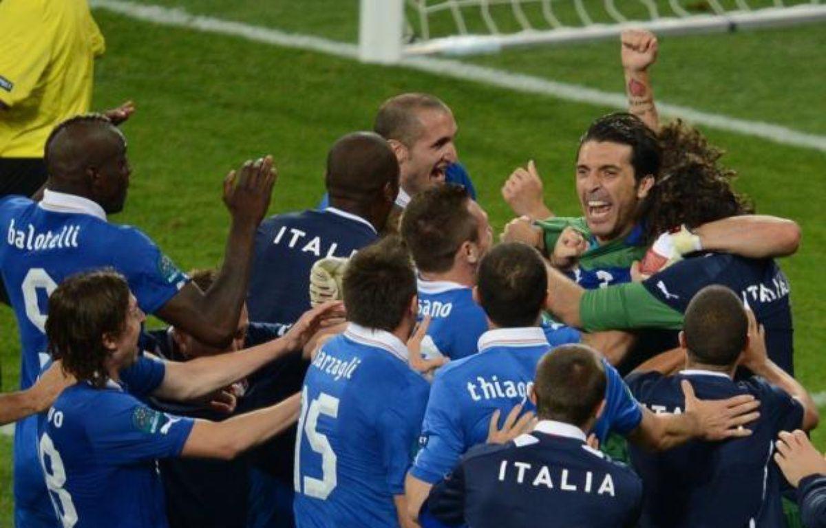 L'Italie retrouve le dernier carré d'une grande compétition à l'Euro-2012 après six ans d'absence, grâce à sa recette de toujours, la culture défensive et le don de la compétition, et a au moins effacé l'échec du Mondial sud-africain. – Jeff Pachoud afp.com