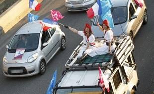 Paris le 08 decembre 2013. Manifestation avec des voitures, des velos, des sympathisants de la Manif Pour Tous dans les rues de paris et sur le peripherique parisien.