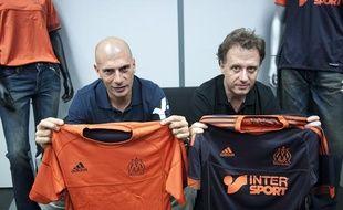 Le chanteur Akhenaton et le designer Pablo Reinoso presentent le nouveau maillot 2012-2013 de l'equipe de l'Olympique de Marseille, le 89 mai 2012.