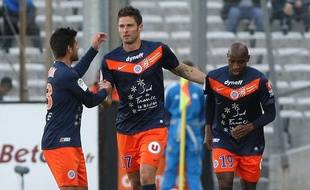 Olivier Giroud (au centre), Marco Estrada (à gauche) et Souleymane Camara (à droite), lors de la victoire de Montpellier face à l'Olympique de Marseille le 11 avril 2012.