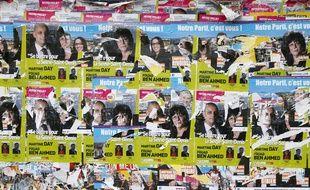 Un mur recouvert d'affiches pour les élections départementales de 2015
