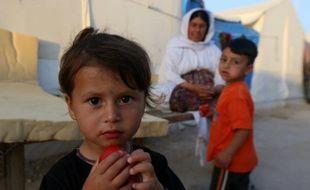 Des Irakiens de la communauté chrétienne Yazidi menacés par le groupe EI sétaientt réfugiés à Sinjar, ici en 2015.