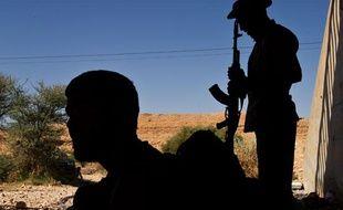 Des combattants anti-Kadhafi à un checkpoint sur la route de Bani Walid, en Libye, le 12 septembre 2011.