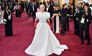 Lady Gaga poses on the red carpet for the 87th Oscars on February 22, 2015 in Hollywood, California. AFP PHOTO/ MLADEN ANTONOV / AFP / MLADEN ANTONOV