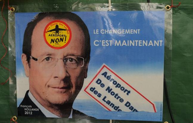 A Francois Hollande campaign poster hijacked by opponents to the airport