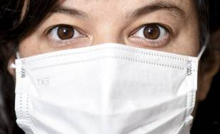Une femme portant un masque pendant l'épidémie de Covid-19.