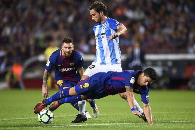Paul Baysse au duel avec Messi et Luis Suarez sous le maillot de Malaga.