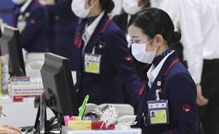 A l'aéroport de Wuhan, le masque est déjà de rigueur.