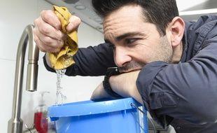Illustration d'un homme faisant le ménage
