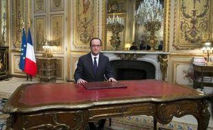 François Hollande lors de son allocution à l'occasion de la nouvelle année, le 31 décembre 2014 à l'Elysée