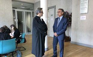 Guy Novès et son avocat Laurent Nougarolis au tribunal des prud'hommes de Toulouse, le 22 mai 2018.