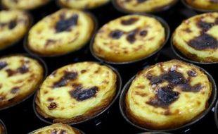 """Le traditionnel """"pastel de nata"""", une tartelette à la crème brûlée que l'on trouve partout au Portugal, souhaite gagner de nouveaux adeptes aux quatre coins du monde grâce à une chaîne de cafés qui veut exporter l'art de vivre lisboète."""
