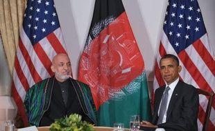 """Les présidents américain Barack Obama et afghan Hamid Karzaï ont réaffirmé jeudi lors d'une vidéo-conférence leur volonté de poursuivre leur """"partenariat"""", après plusieurs jours de tensions dues à l'incinération d'exemplaires du Coran par des soldats américains"""