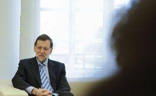 """Le chef du gouvernement de droite espagnol, Mariano Rajoy, a affirmé mercredi que sa première année au pouvoir avait permis d'éviter """"le naufrage"""" du pays, assurant que le déficit public se situerait en 2012 """"à moins de 7%"""" du PIB."""