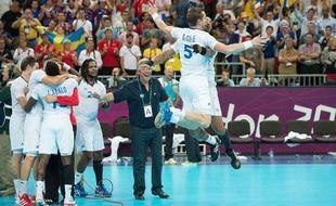 Guillaume Gille célèbre avec Didier Dinart le titre olympique à Londres, le 12 août 2012