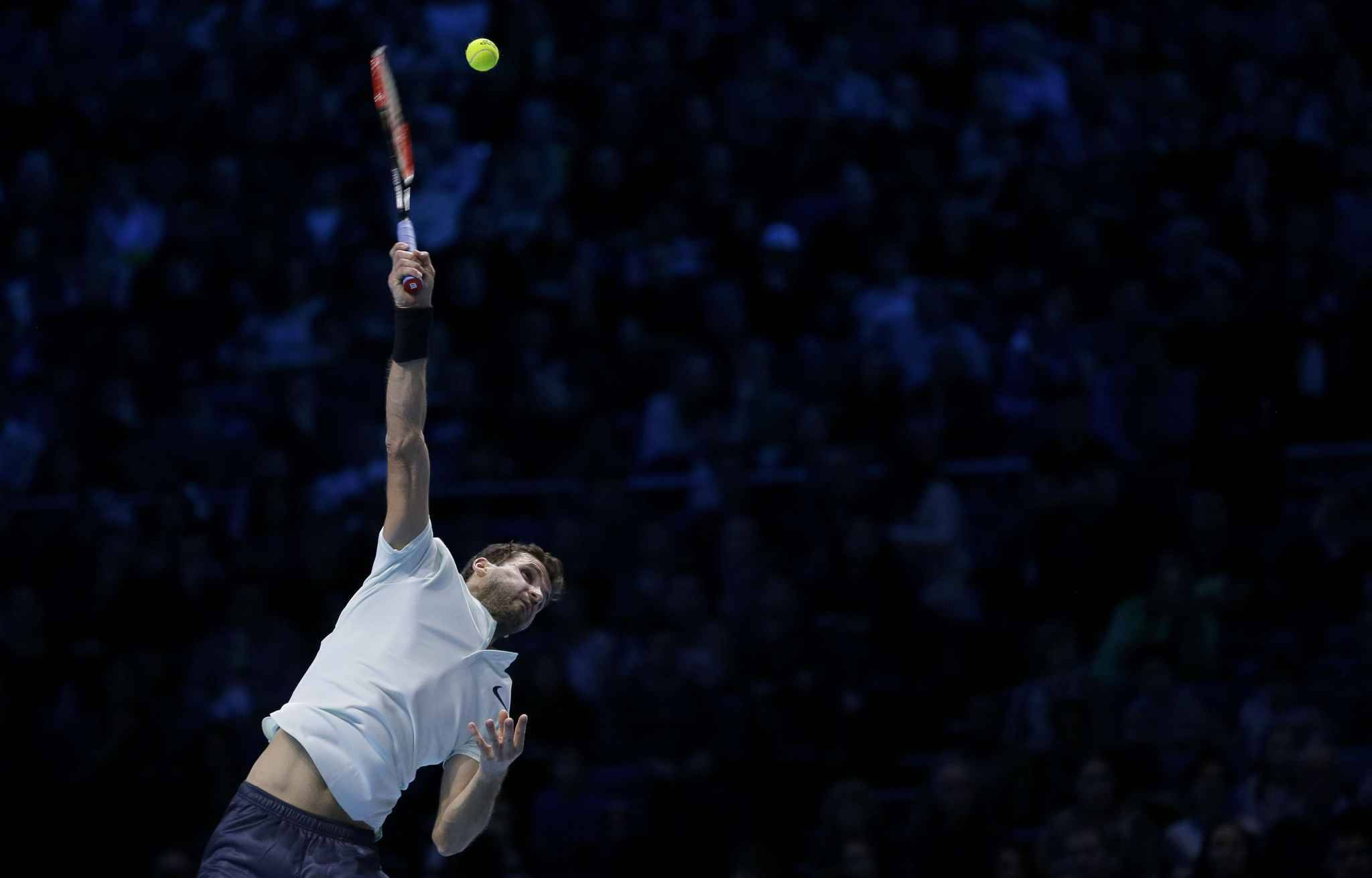 Grigor Dimitrov of Bulgaria serves to David Goffin of Belgium during their ATP World Tour Finals singles final tennis match at the O2 Arena in London, Sunday Nov. 19, 2017.