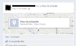 Un utilisateur de Facebook utilise le «check-in» le 6 mai 2012, après l'annonce des résultats.