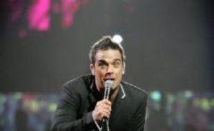 Robbie Williams refuse de fournir son prochain album en cours d'enregistrement à sa maison de disque EMI en signe de désaccord avec ses nouveaux patrons, a déclaré le manager du chanteur britannique dans le Times de vendredi.