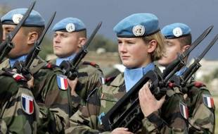 """French soldiers take part in a Medal Parade at the former hippodrome of the ancient Lebanese southern city of Tyre, 05 January 2007. With a 1,600-strong force of """"blue helmets"""", France is the second largest contributor to UNIFIL, beefed up after the UN-brokered truce between Lebanon and Hezbollah took effect on August 14 France will transfer command of the 11,000-strong force to Italy, the main contributor with 2,300 soldiers, in the coming weeks. AFP PHOTO/JOSEPH BARRAK"""