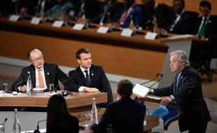World Bank President Jim Yong Kim (L) and French President Emmanuel Macron (2nd L) listen as United Nations (UN) Secretary General Antonio Guterres delivers a speech at the One Planet Summit on December 12, 2017, at La Seine Musicale venue on l'ile Seguin in Boulogne-Billancourt, west of Paris.