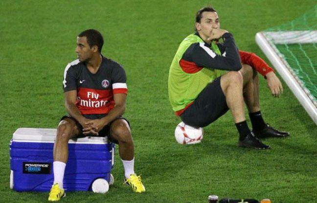 Lucas Moura et Zlatan Ibrahimovic lors du stage du PSG au Qatar le 1er janvier 2013.
