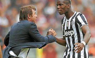 Antonio Conte (ici avec le Français Paul Pogba) a déjà gagné deux Scudetti avec la Juventus Turin.