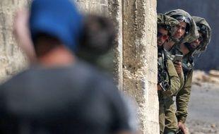 Des soldats israéliens pendant la manifestation hebdomadaire à la frontière de la bande de Gaza.