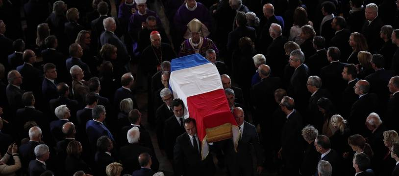 The coffin of late French President Jacques Chirac is carried out of Saint Sulpice church after his final service Monday, Sept. 30, 2019 in Paris. Former French President Jacques Chirac was given full military honors on Monday as past and current world leaders gathered in Paris to attend his final service.