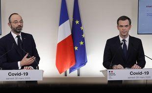 Coronavirus: Edouard Philippe et Olivier Véran lors de leur conférence de presse conjointe, le 28 mars 2020.