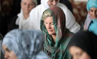 Une femme portant un foulard en signe de respect pour la communauté musulmane, le 22 mars 2019.