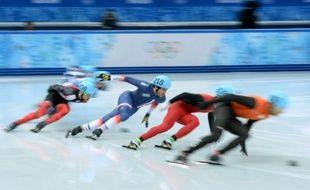 Le Français Thibaut Fauconnet, (en troisième), lors des Jeux olympiques de Sotchi, le 10 février 2014