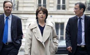 Jean-Marc Germain, directeur de cabinet de de Martine Aubry, Martine Aubry et François Lamy, conseiller politique de la première secrétaire du PS, le 16 mai 2011, rue de Solferino à Paris.